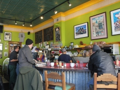 """Cafe Jumping Bean's customers are as varied as the neighborhood that surrounds it. """"You'll see everybody from your grandparents who lived here all their lives with their grandkids, to all the new hipster kids that they're talking about,"""" Delgado says."""