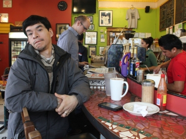 """Jose Mendez says he was one of the first customers at Cafe Jumping Bean when he started coming in as a teenager. Now 36, Mendez has become one of the cafe's regulars. """"It feels like a family here,"""" he says."""