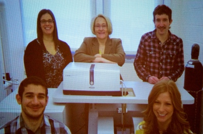 "Neurologist Michelle Block is seen here with ""Big Betty"" an electron paramagnetic resonance spectrophotometer and other members of her lab at Virginia Commonwealth University."