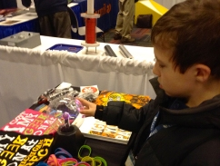 Noah Oxer, 11, of Oak Park, learns about electrons through the use of a plasma ball at Michigan Tech's Mind Trekkers booth.