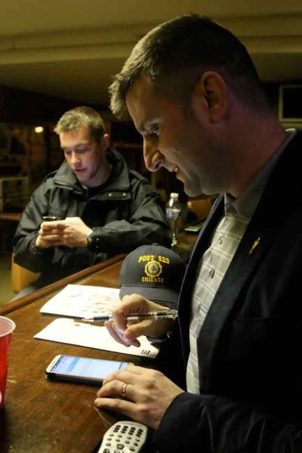 "Paul Knudston, 40, right, leader of American Legion Post 623, checks the group's social media pages often. He's attempting to revitalize the post to adapt to modern times and calls it a ""cyber post"" because they do not have a building or office space. With him is veteran Peter Kalenik, 29."