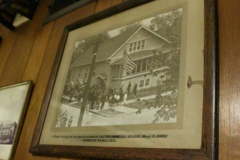 Built by veterans of WWI, Post 414 has been in Forest Park since in 1921. Photographs line the walls of the first floor recreation room, including a flag raising at the dedication of the Memorial Hall on May 7, 1922, in Forest Park.