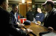 """Knudston, center, says that even though the emphasis is on creating a """"cyber post"""" for his group to engage young veterans, in-person contact is still important. Many of the veterans at the Friday night hangout event work as advocates for veterans in several organizations."""