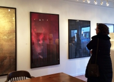 "A gallery viewer checks out Manning's ""Grim Sleeper"" series. The oversized works range from $2,500 to $4,000."