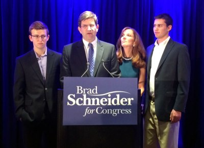 Brad Schneider with wife Julie and sons Daniel and Adam during his concession speech on Tuesday night.