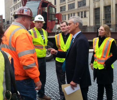 Mayor Rahm Emanuel greets Chicago Department of Transportation crewmembers Tuesday at the Van Buren Bridge.  The bridge will open for traffic by Thursday at noon.