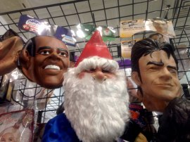 Masks of President Obama, Santa Claus, and Charlie Sheen hang off the rack at the Halloween Hallway in the Chicago Loop.