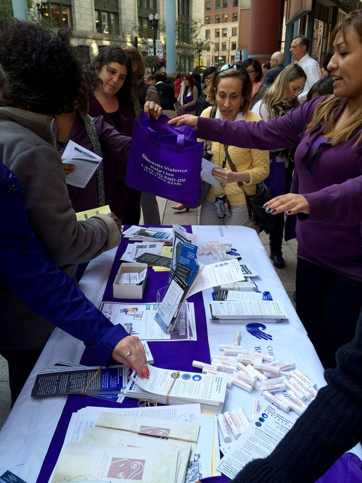 Advocates from the Chicago Metropolitan Battered Women's Network passed out information at a recent Domestic Violence Awareness month kick-off rally in downtown Chicago. This October, advocates are highlighting the issue of financial abuse.