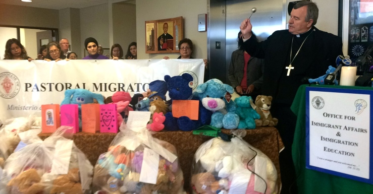 The Most Rev. John Manz blesses the donated stuffed animals at the Cardinal Meyer Center, South Lake Park Ave. Chicago