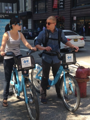 "Iwen Lai and Kenyon Mayeda rented Divvy bikes Sept. 29 while visiting Chicago from Los Angeles. Lai said she borrowed a bike for its affordability and convenience, adding, ""It's also good for the environment."""