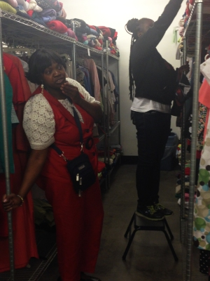 Memory Kadanga helps women pick out clothing from Pacific Garden Mission. Clothes the Chicago marathon, including sweaters and jogging pants, added to the supply of clothing available to homeless people in the city.
