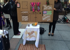 """The organization used a large-scale art installation and a staged demonstration to show the plight of a victim of domestic violence from the """"shoes"""" of a woman trying to flee the situation. Her journey began in this cardboard replica of a kitchen."""