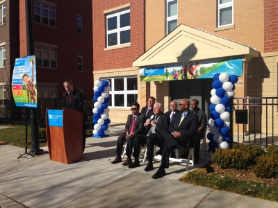 Tim McCormick, CEO of SOS Children's Villages Illinois address the crowd in front of one of the newly constructed homes in the Roosevelt Square Village in Chicago's West Side.