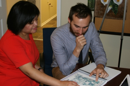 Kedzie Center Executive Director, Dr. Angela Sedeño, and Program Development Coordinator, Matthew Hiller discuss a map of neighborhoods that the Kedzie Center will serve.  Photo by Sara Freund.