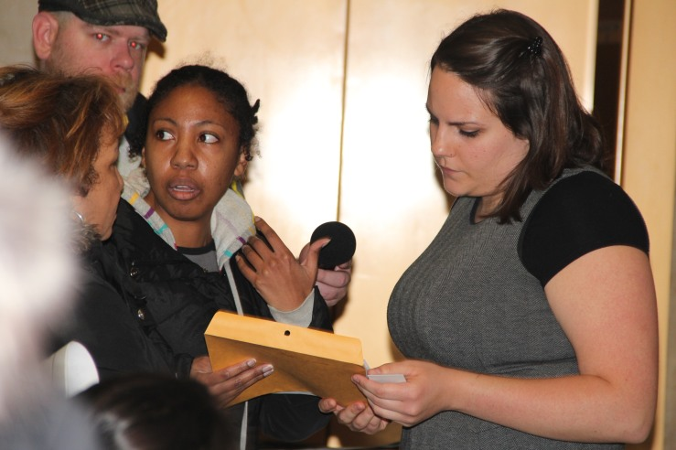 Becky Brasfield hands a letter to Mayor Rahm Emanuel's representative. Photo by Kari Lydersen