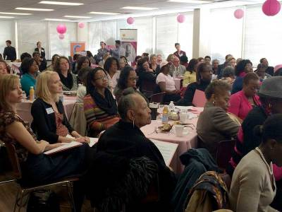 Attendees listen to the findings of the study at last week's Beyond October event at the Chicago Urban League.