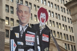 Demonstrators carried signs depicting City Hall's close ties with corporations such as McDonald's. (Michael Epstein/Medill News Service)