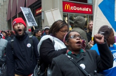 Shouts echoed outside the McDonald's store on South Financial Place (Michael Epstein/Medill News Service)