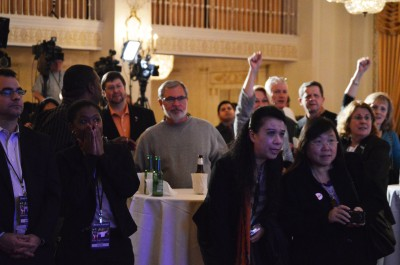 Supporters of Tom Cross watch as Republican numbers rise during election night.