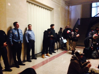 Chicago police officers observe the crowd but didn't intervene with the sit-in.