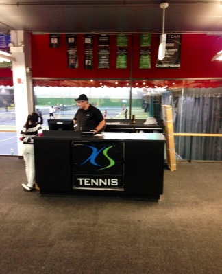 XS Tennis reception area at its current facility in a Hyde Park LA Fitness. XS Tennis Village, a 112,000-square-foot center, will be the new home of the organization in  spring 2015.
