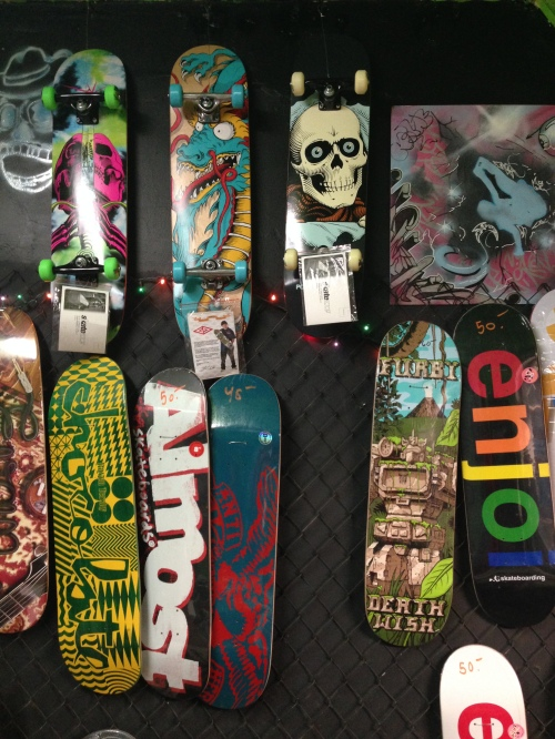 Artistic skateboards showcased at Wilson Yards Skate Shop in Uptown, Chicago.