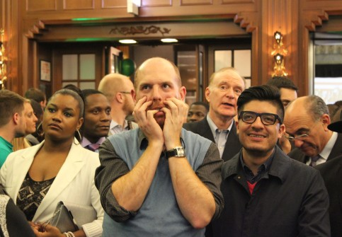 """Eric McKeeby (left) watches the returns with his partner, Omar Neri (right) at Gov. Quinn's election night party. """"I really like the way Quinn has supported initiatives like marriage equality and other programs that support those who are vulnerable,"""" McKeeby said."""