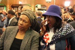 Marry Edmonds (right) is emotional with her friend, Josephine Hamilton Perry (left), as Quinn supporters learn Republican challenger Bruce Rauner has won the election.
