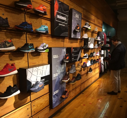 A customer scopes out a new pair of sneakers at Niketown Chicago. Joe Musso / Medill