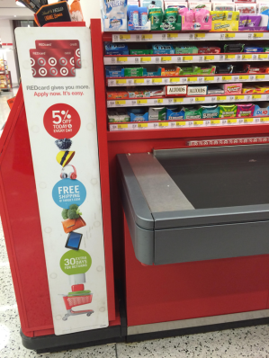 Target advertises its company credit card, the REDcard, to customers at checkout aisles, pushing for customer loyalty. (Melissa Enaje/Medill News Service)