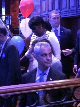 Mayor Rahm Emanuel heads out before Secretary of State Jesse White arrives to his own election night party Tuesday.