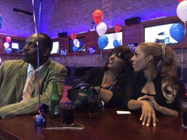Jesse White supporters Christopher Thompson, Gloria Phillips and Brandye Phillips watch for poll numbers as they come through.