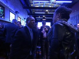 Jesse White speaks with a supporter.