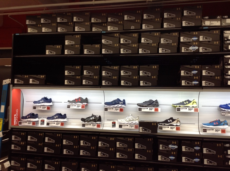A selection of Under Armour shoes at a Sports Authority Store on North LaSalle Street, Chicago (Nick Kariuki/Medill)