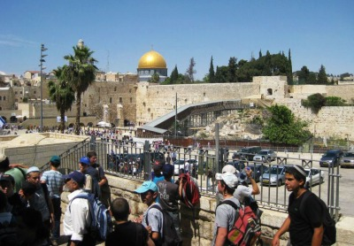 Tourists visit the Kotel, or the Western Wall, in Jerusalem.