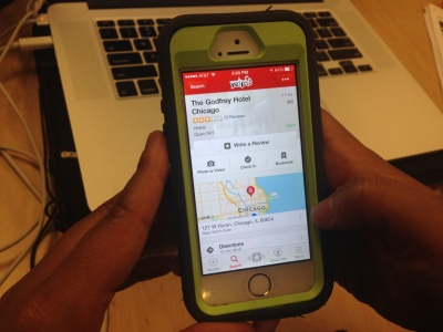 A Yelp users looks at the page for the Godfrey Hotel.  The Chicago hotel subscribes to Check Mate, a mobile platform that allows hotels to track the social influence of its guests. / megan k. rauch / MEDILL