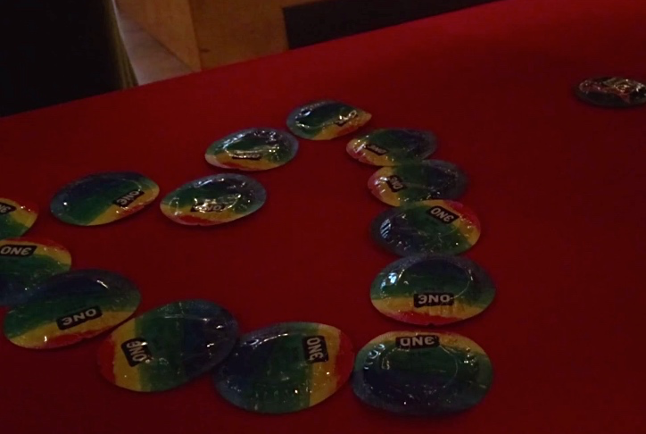 A display of free condoms adorns a table at CALOR's World AIDS Day event. Adrienne Hurst/MEDILL